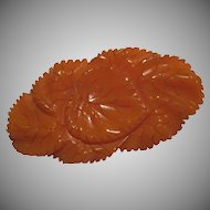 Orange Carved Lily Pad Bakelite Pin