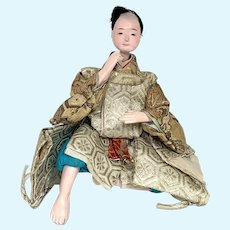 Japanese wooden hina doll, male in damask clothing
