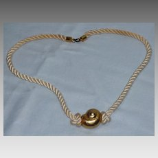 Vintage 1970s Yves Saint Laurent Gold Tone Shell Pendant Necklace On Cord