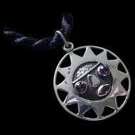 BEJEWELED Ecuadorian Mid-century Handcrafted .925 Silver Pre-Columbian TRIBAL SUN PENDANT with Garnet Gemstone Embellishments