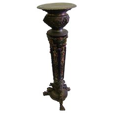 Victorian Majolica and heavy spelter 19th century Pair of pedestals with lions puttis flowers