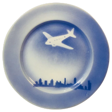 O.P.C.O. Syracuse Blue Plate with Airplane Motif