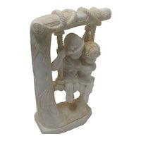 Marble Statue Of Two Children On Swing