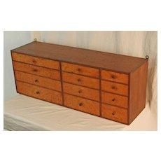 Walnut and Birdseye Multi-Drawer Cabinet