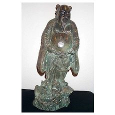 An antique/vintage Chinese bronze statue of an immortal