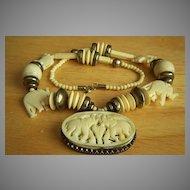 Amazing vintage bone necklace with large carved elephant pendant