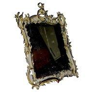 Bronze slanting mirror signed NB&ID Company