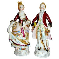 Vintage porcelain stature of a colonial couple, mid 20th c.