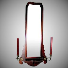 Mahogany wall mirror with removable brass candleholders, circa 1930