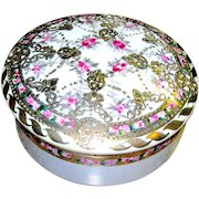 Nippon covered dish with pink and red flowers highly embellished in gold and signed