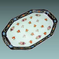 Vintage Japanese porcelain tray with a motif of flowers