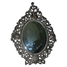 Antique Slanting Spelter Metal  Mirror, beveled with original mirror