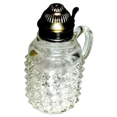 Antique Hand Blown Clear Syrup with a motif of raised star hobnails, about 1870
