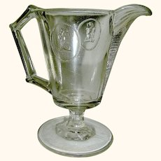 EAPG clear creamer pitcher in Classic Cameo Medallion circa 1870