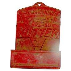 Vintage cast iron match holder and striker