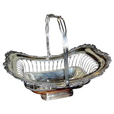 Silver Plate Basket with open work and decorated swing handle: 3 crowns mark
