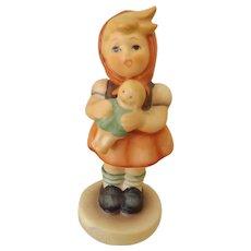 Girl Holding Doll--Gobel Hummel