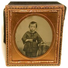 Sixth Plate Ambrotype of Child with Toy Dog