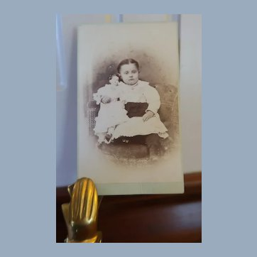 Lovely CDV Of Child Sitting On Chair With Her China Head Doll