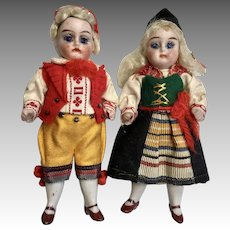 German All Bisque Doll Pair All Original Factory Clothes Glass Eyes