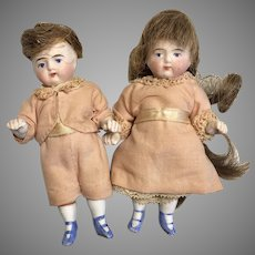 2 Adorable Early All Bisque Stiff Hip Blue Boot Twin Doll Pair