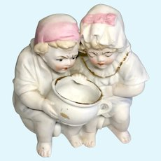 Unusual German All Bisque 2 Doll Potty Pair Figurine