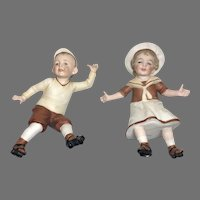 2 All Bisque German Roller Skating Boy Girl Character Doll Molded Clothes Hats