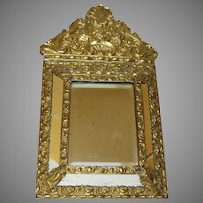 Antique French Pressed Brass Repousse Cushion Mirror