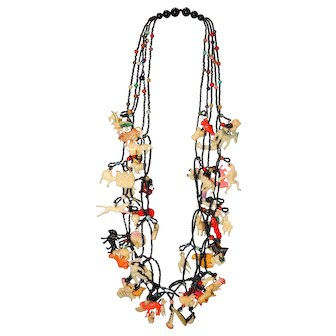 """Vintage 26"""" Necklace with 55 Celluloid Charms"""
