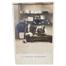 1906 Undivided Back Vintage Photo Postcard A Pressing Engagement Man Getting Pants Pressed