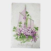 1910 An Easter Greeting Embossed Postcard Sailboat & Purple Flowers