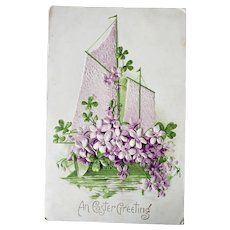 1910 An Easter Greeting Embossed Postcard Sailboat & Purple Flowers