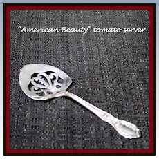 American Beauty tomato server in sterling by Manchester Silver Co.