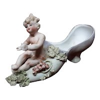 Antique Art Nouveau Bisque Cherub With Shoe Figurine