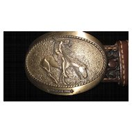 ADM End Of The Trail Oval Buckle on Brown and White Braided Belt
