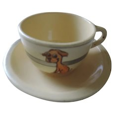 Roseville Child's Cup and Saucer, Cartoon Dog