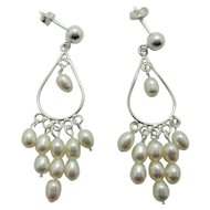 Elegant Sterling Silver And White Lotus Pearl Infinity Earrings