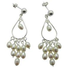 Elegant Sterling Silver And White Lotus Pearl Infinity Earrings