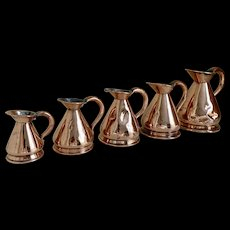 A Small Set of Antique English Copper Measures