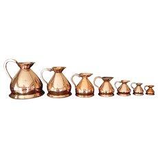 Set of Seven Antique English Copper Measures, Ale, Wine, Spirits