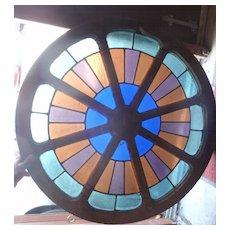 Unusual stained glass wagon wheel window