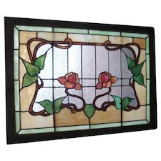 Beautiful glass in the roses in this early 20th century window
