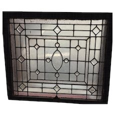 Turn of the century stained glass window with clear jewels and bevels