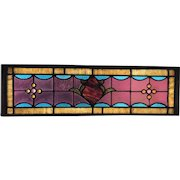 One of a pair of stained glass transoms