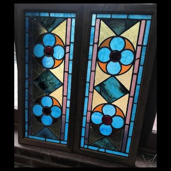 Matched pair of vibrant stained glass window