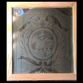 Wheel cut etched stained glass panel featuring bird motif
