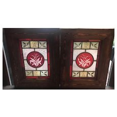 One of a matched pair of ruby etched stained glass panels