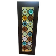 One of four rare  and unusual roundel stained glass windows