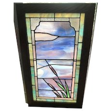 Scenic cattail stained glass window