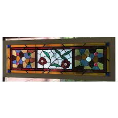 Nicely jeweled floral transom window